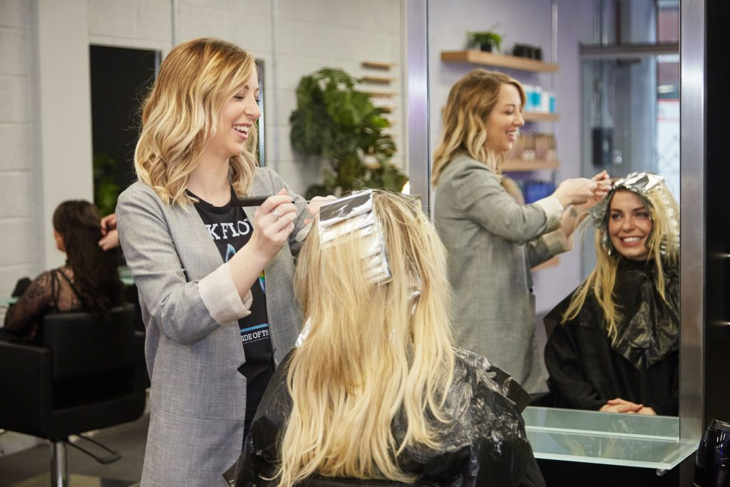 Owner of Kopper Hair Salons Sabrina Hill tending to Anna Geary of Ireland's Fittest Family fame's crowning glory. Picture: Miki Barlok